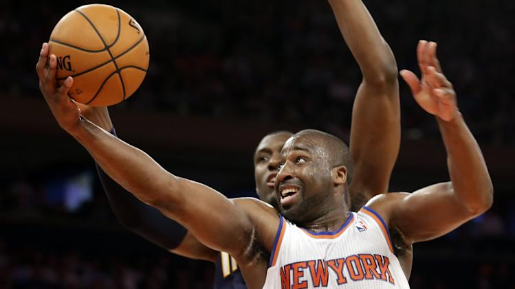 New York Knicks' Raymond Felton (2) goes up for a shot against Indiana Pacers' Ian Mahinmi in the second half of Game 5 of an Eastern Conference semifinal in the NBA basketball playoffs, at Madison Square Garden in New York, Thursday, May 16, 2013. (AP Photo/Julio Cortez)