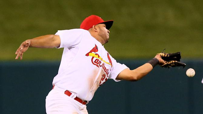 St. Louis Cardinals shortstop Jhonny Peralta drops a fly ball off the bat of Chicago Cubs' Anthony Rizzo that allowed a run to score in sixth inning during a baseball game Monday, May 4, 2015, in St. Louis. Peralta was charged with an error on the play. (Chris Lee/St. Louis Post-Dispatch via AP)