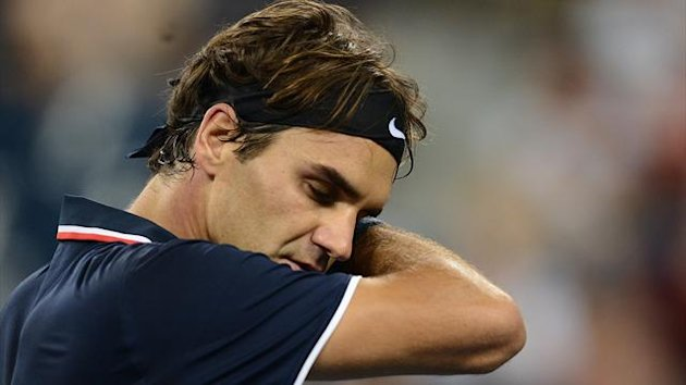 Roger Federer during his 2012 US Open defeat to Tomas Berdych (AFP)