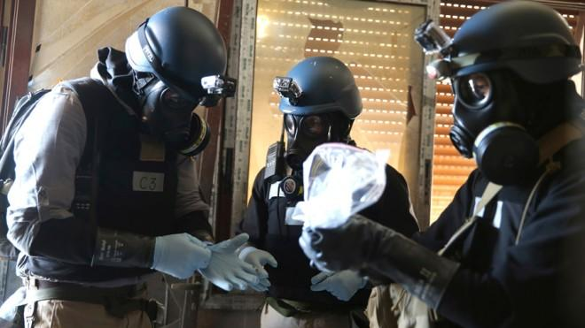 U.N. chemical weapons experts examine samples from one of the sites of the alleged attack in Damascus on Aug. 29.