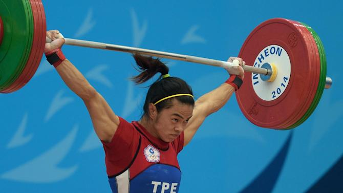 Taiwan's Shu Ching Hsu wins gold in the women's 53kg weightlifting at Asian Games in Incheon on September 21, 2014