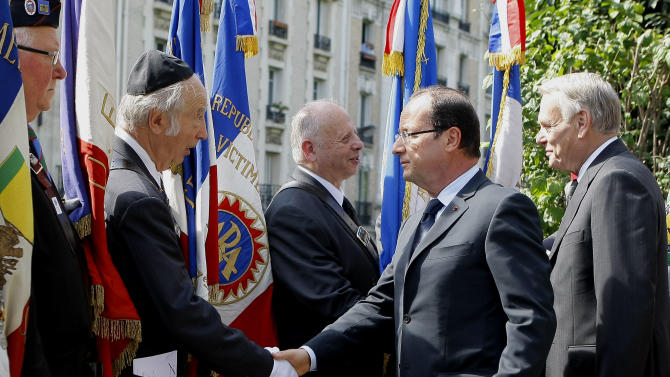 French President Francois Hollande, second left, and Prime Minister Jean-Marc Ayrault, left, shake hands with veterans at the Jewish memorial during ceremonies to mark the commemoration of the 70th anniversary of the Vel d'Hiv roundup, Sunday July 22, 2012 in Paris. France paid tribute to the memory of 13,152 Jews rounded up in 1942 by French police and sent to Nazi death camps in one of the worst incidents of wartime collaboration.(AP Photo/Jacques Brinon Pool)
