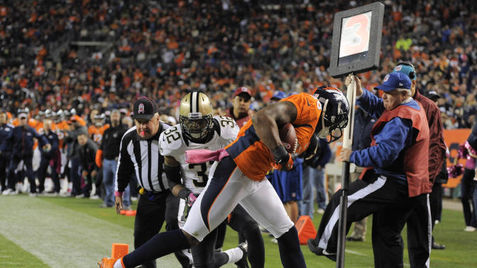 Denver Broncos wide receiver Demaryius Thomas (88) comes down with a pass for a touchdown as New Orleans Saints defensive back Johnny Patrick (32) defends in the third quarter of an NFL football game, Sunday, Oct. 28, 2012, in Denver. (AP Photo/Jack Dempsey)