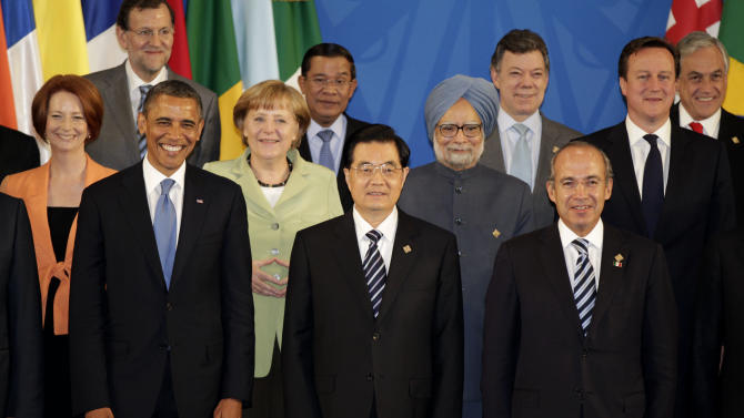 Leaders of the G-20 and guests pose for the family photo in Los Cabos, Mexico, Monday, June 18, 2012. From left,  Australian Prime Minister Julia Gillard, Spain's Prime Minister Mariano Rajoy,  President Barack Obama, Germany's Chancellor Angela Merkel, Cambodia's Prime Minister Hun Sen, China's President Hu Jintao, India's Prime Minister Manmohan Singh, Colombia's President Juan Manuel Santos, Mexico's President Felipe Calderon, British Prime Minister David Cameron and Chile's President Sebastian Pinera. (AP Photo/Eduardo Verdugo)