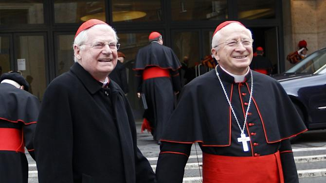 """Cardinal Angelo Scola, left, holds hands with Cardinal Ennio Antonelli as they arrive for an afternoon meeting, at the Vatican, Friday, March 8, 2013. The Vatican says the conclave to elect a new pope will likely start in the first few days of next week. The Rev. Federico Lombardi told reporters that cardinals will vote Friday afternoon on the start date of the conclave but said it was """"likely"""" they would choose Monday, Tuesday or Wednesday. The cardinals have been attending pre-conclave meetings to discuss the problems of the church and decide who among them is best suited to fix them as pope. (AP Photo/Alessandra Tarantino)"""