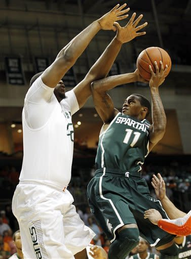 Miami beats No. 13 Michigan State 67-59