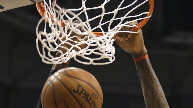 Miami Heat's LeBron James dunks against the Milwaukee Bucks in the first half of an NBA basketball game Friday, March 15, 2013, in Milwaukee. (AP Photo/Jeffrey Phelps)