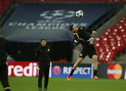 Dortmund's Robert Lewandowski of Poland controls a ball during a training session at Wembley Stadium in London, Friday May 24, 2013. Dortmund will face fellow German soccer team Bayern Munich in the f