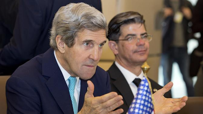 U.S. Secretary of State John Kerry, left, gestures during a meeting of the U.S.-Algeria Strategic Dialogue in Algiers, Algeria Thursday April 3, 2014. (AP Photo/Jacquelyn Martin, Pool)