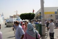 <p>People look on as clouds of tear gas rise in a street in Sidi Bouzid, August 9. Police fired tear gas and rubber bullets to disperse a second anti-government protest in the central Tunisian town of Sidi Bouzid, birthplace of last year's revolution</p>