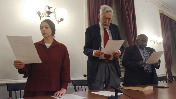 Members of Vermont's electoral college take their oath of office on Monday, Dec. 17, 2012 in Montpelier, Vt. The three Vermonters have cast the state's votes in the Electoral College that will formally elect President Barack Obama to a second term. Vermont was the first state whose electoral votes were placed in the column of President Obama and Vice President Joe Biden. From left, Sherry Merrick of Post Mills, William Sander of Jeffersonville and State Rep. Kevin Christie of Hartford.  (AP Photo/Toby Talbot)