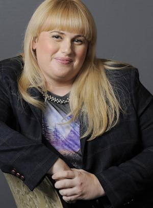 """FILE - In this Thursday, Aug. 23, 2012 file photo, actress, writer and comedienne Rebel Wilson, a cast member in the film """"Bachelorette,"""" poses for a portrait at the Four Seasons Hotel in Beverly Hills, Calif. Wilson sings, dances and summons laughs _ and that's just in the opening moments of the upcoming MTV Movie Awards, on Sunday, April 14, 2013. The Australian actress is hosting the show, and she's set to start the ceremony by singing solo. (Photo by Chris Pizzello/Invision/AP, File)"""