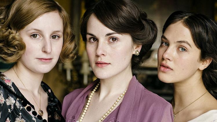"Laura Carmichael stars as Lady Edith Crawley, Michelle Dockery stars as Lady Mary Crawley, and Jessica Brown-Findlay stars as Lady Sybil Crawley in ""Downton Abbey."""