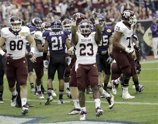 Aggies get 33-22 win over Northwestern