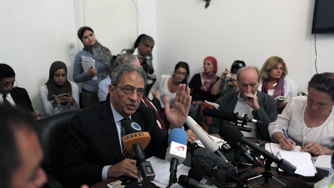 FILE - In this Sunday, April 22, 2012 file photo, Egyptian presidential candidate Amr Moussa, center, speaks during a press conference at his residence in Cairo, Egypt. In the race to become the first president of the new Egypt, the secular candidate with the strongest chance of beating increasingly powerful Islamists has to overcome the baggage he brings from the old Egypt. On the campaign trail ahead of next month's landmark vote, the 76-year-old Amr Moussa presents himself as an elder statesman with years of experience in politics and government, first from a decade as foreign minister under former President Hosni Mubarak, then from another decade leading the Arab League.(AP Photo/Nasser Nasser, File)