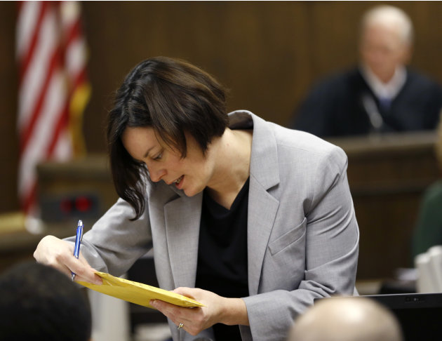 Prosecuting attorney Marianne Hemmeter, left, looks at evidence during the rape trial for 17-year-old Trent Mays and 16-year-old Ma'lik Richmond in juvenile court on Thursday, March 14, 2013 in Steube