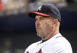 Braves manager Gonzalez watches from the dugout in the fourth inning during play against the Milwaukee Brewers at their MLB National League baseball game in Atlanta