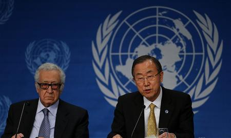 U.N. Secretary-General Ban Ki-moon sits beside U.N.-Arab League envoy for Syria Lakhdar Brahimi (L) as he addresses a news conference after the Geneva-2 peace talks in Montreux January 22, 2014. REUTERS/Arnd Wiegmann
