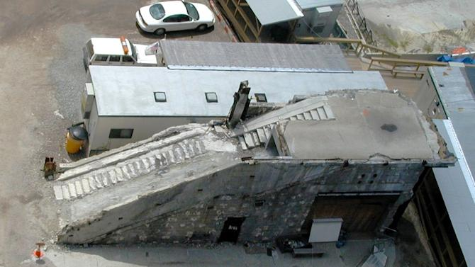"""FILE - This undated file photo provided by the National Trust for Historic Preservation shows the World Trade Center Vesey Street staircase in New York. The National Trust for Historic Preservation has released its annual list of America's 11 Most Endangered Historic Places, which once included the staircase, which is now listed as """"saved."""" Before the 2001 terrorist attacks, the stairs consisted of two granite-clad flights of stairs and an escalator that led from the trade center plaza to Vesey Street. When the towers collapsed, the heavily damaged stairs served as an escape route for hundreds of people.  In 2008, the staircase was installed at the below-ground memorial museum being constructed at ground zero. (AP Photo/Robert Kornfeld, Jr. and Richard Zimbler, National Trust, File)"""