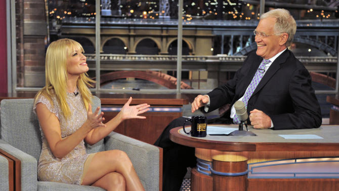 """FILE - In this May 7, 2012 file photo provided by CBS, Beth Behrs, co-star of """"Two Broke Girls"""" talks with host David Letterman on the set of the """"Late Show with David Letterman,"""" in New York. Hurricane Sandy didn't just halt airline flights and the stock market on Monday, Oct. 29, 2012, it also caused widespread cancellations across the entertainment industry. David Letterman and Jimmy Fallon are doing their shows without an audience because of the storm. (AP Photo/CBS, John Paul File) MANDATORY CREDIT; NO ARCHIVE; NO SALES; NORTH AMERICAN USE ONLY"""