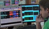 "Ann Indian stock dealer watches share prices on his terminal at a brokerage house in Mumbai in 2011. India said on Saturday its financial markets were safe from ""systemic risk"" after a more than 900-point ""flash crash"" in the National Stock Exchange's Nifty index caused by erroneous trading orders"