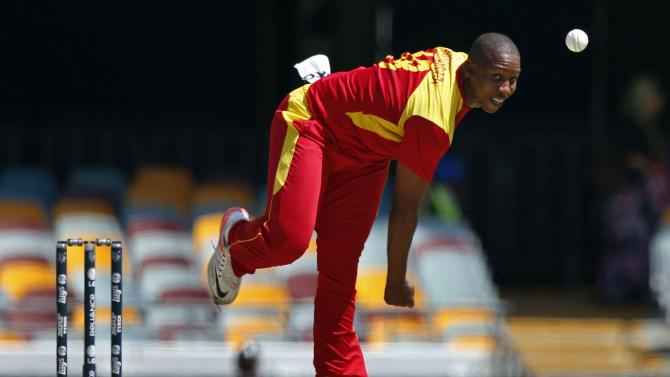 Zimbabwe's Tinashe Panyangara bowls during the Cricket World Cup match against Pakistan at the GABBA in Brisbane