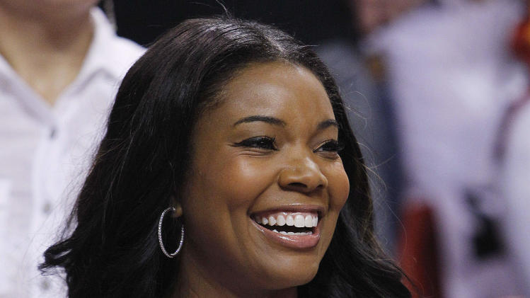 Miami Heat's Dwyane Wade's girlfriend Gabrielle Union watches Game 5 of the NBA finals basketball series against the Oklahoma City Thunder, Thursday, June 21, 2012, in Miami. (AP Photo/Lynne Sladky)