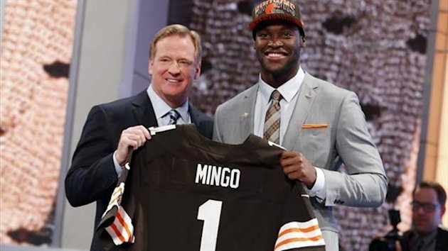 Barkevious Mingo (R) from Louisiana State University stands with NFL Commissioner Roger Goodell after being selected by the Cleveland Browns as the sixth overall pick in the 2013 Draft (Reuters)