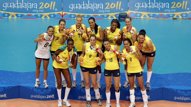 Brazil´s players pose after beating Cuba during the women's volleyball medal ceremony at the Pan American Games in Guadalajara, Mexico, Thursday, Oct. 20, 2011. Brazil won 3-2. (AP Photo/Daniel Ochoa de Olza)
