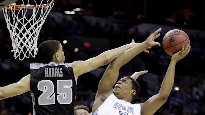 North Carolina's Kennedy Meeks (3) shoots as Providence's Tyler Harris (25) defends during the first half of a second-round game in the NCAA college basketball tournament Friday, March 21, 2014, in San Antonio