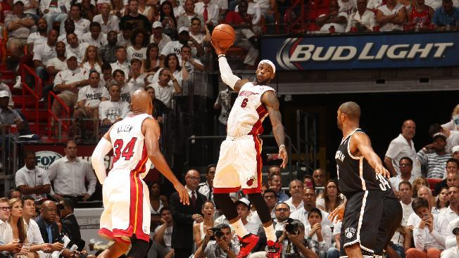 Heat rally past Nets to East finals, 96-94