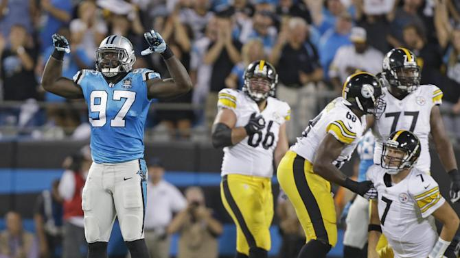 Carolina Panthers' Mario Addison (97) celebrates a sack of Pittsburgh Steelers' Ben Roethlisberger (7) during the first half of an NFL football game in Charlotte, N.C., Sunday, Sept. 21, 2014. (AP Photo/Bob Leverone)