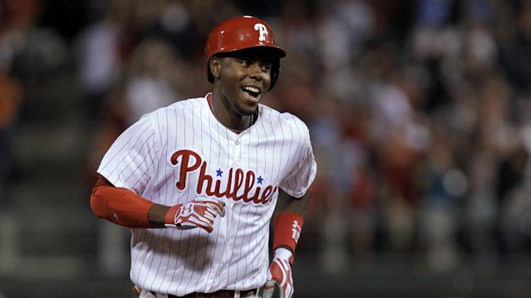 Philadelphia Phillies' John Mayberry Jr.rounds the bases after hitting a grand slam in the 11th inning of a baseball game against the Miami Marlins, Tuesday, June 4, 2013, in Philadelphia. The Phillies won 7-3. (AP Photo/Laurence Kesterson)