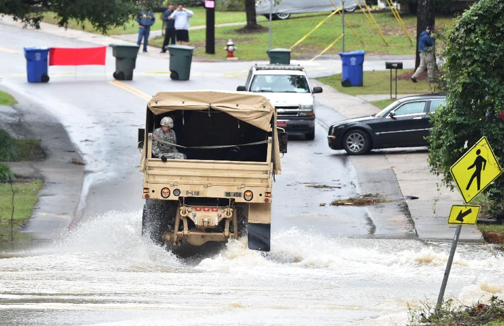 Record floods kill 11 in US state of South Carolina