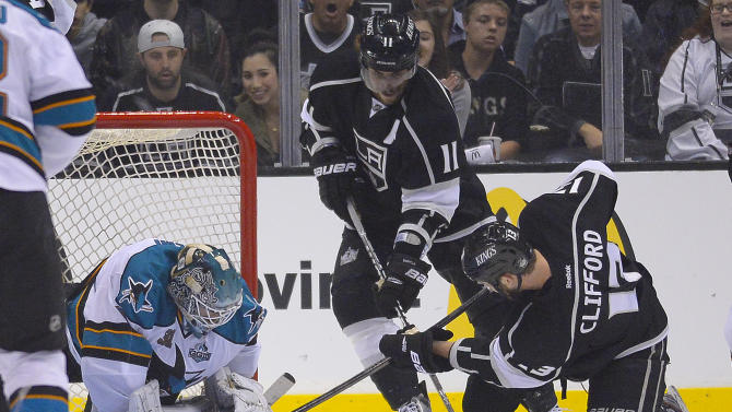 Los Angeles Kings left wing Kyle Clifford (13) and center Anze Kopitar (11) look to score against San Jose Sharks goalie Antti Niemi (31) in the first  period during Game 5 of the Western Conference semifinals in the NHL hockey Stanley Cup playoffs, Thursday, May 23, 2013, in Los Angeles. (AP Photo/Mark J. Terrill)
