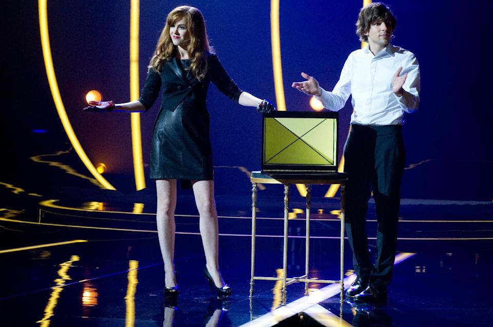 "This film image released by Summit Entertainment shows, from left, Isla Fisher and Jesse Eisenberg in a scene from ""Now You See Me."" (AP Photo/ Summit Entertainment, Barry Wetcher)"