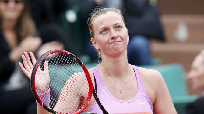 Petra Kvitova of the Czech Republic celebrates after beating Silvia Soler Espinosa of Spain during their women's singles match at the French Open tennis tournament at the Roland Garros stadium in Paris