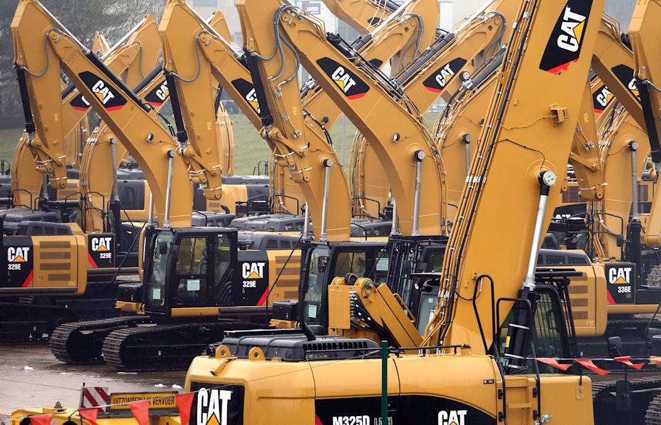 Caterpillar 1Q profit shrank; cuts 2013 outlook