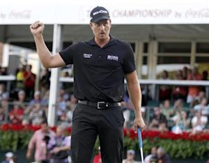 Stenson of Sweden reacts after sinking his putt to win the Tour Championship golf tournament and the FedExCup in Atlanta