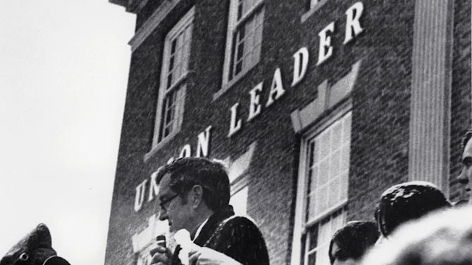 FILE  This Feb. 26, 1972 file photo shows Sen. Edmund Muskie, D-Maine, denounces conservative Manchester Union Leader publisher William Loeb in front of the newspaper's Manchester, N.H., building.  Muskie's emotional speech came as he campaigned for the New Hampshire primary and the Democratic presidential nomination, which slid off the tracks after it was reported that he had cried in response to the newspaper's attack on his wife. Muskie sustained until his death that it had been melted snowflakes, not a tear, in his eye. It seems a strange sight: The president of the United States, sometimes called the most powerful person in the world, breaking down in tears thanking campaign workers for their tireless _ and ultimately successful _ work on his behalf. But Barack Obama isn't the only world leader unashamed or unable to avoid being seen crying in public.   (AP Photo, File)