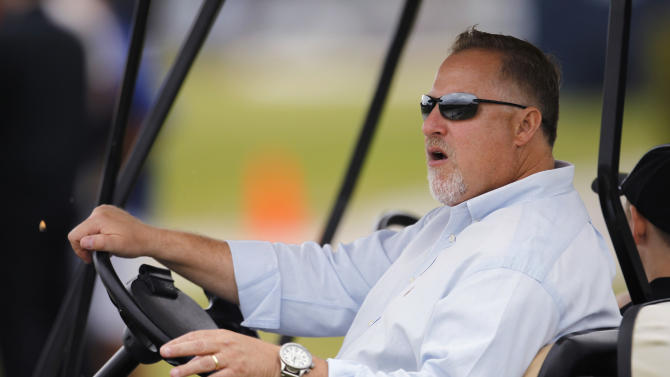 In this Feb. 26, 2012, photo, Larry Beinfest, Miami Marlins president of baseball operations, sits in a golf cart during spring training in Jupiter, Fla. Beinfest was fired Friday, Sept. 27, 2013, after 12 years with the Marlins. The move came as the team neared the end of its third consecutive last-place season in the NL East. Marlins owner Jeffrey Loria also fired Jim Fleming, who had also been with the Marlins for 12 seasons and was Beinfest's special assistant. Beinfest and Jennings were dismissed with two years left on their contracts. (AP Photo/Jeff Roberson)