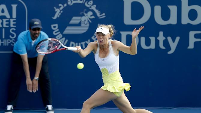 Carolina Wozniacki of Denmark returns to Jie Zheng of China during the third day of Dubai Duty Free Tennis Championships in Dubai, United Arab Emirates, Wednesday, Feb. 20, 2013. (AP Photo/Regi Varghese)