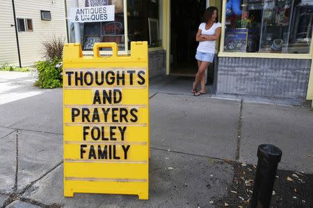 Sign outside a shop remembers James Foley in his hometown of Rochester