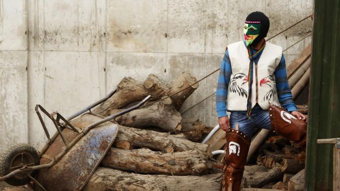 "In this July 14, 2013 photo, masked fighter Alejandro Alvaro wears his costume before taking part in an Andean fight known as Takanakuy in Lima, Peru. Takanakuy, which means ""When the blood is boiling"" in Quechua, is a ritual of unclear providence that predates Spanish colonial rule and happens twice a year, in July and just after Christmas, to settle scores. (AP Photo/Karel Navarro)"
