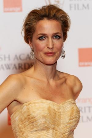 Gillian Anderson poses in the press room at The Orange British Academy Film Awards 2012 at The Royal Opera House on February 12, 2012 -- Getty Images