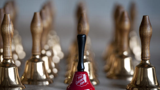 "A red Salvation Arm bell sits on a table at a the temporary site of the Bevin Bros. manufacturing in East Hampton, Conn., Wednesday, Oct. 3, 2012. The 180-year-old New England company that made the tiny bell that tinkles every time an angel gets its wings in the holiday classic ""It's a Wonderful Life"" is resuming production months after the factory was destroyed in a fire. The factory, which is now making bells for Salvation Army bell-ringers, is returning with government grants and private investment. (AP Photo/Jessica Hill)"