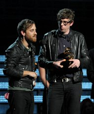 Musicians Dan Auerbach, left, and Patrick Carney of the Black Keys accept the award for best rock performance for &quot;Lonely Boy&quot; at the 55th annual Grammy Awards on Sunday, Feb. 10, 2013, in Los Angeles. (Photo by John Shearer/Invision/AP)