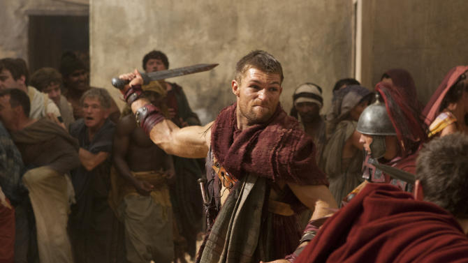 "In this undated file image originally released by Starz, Liam McIntyre portrays the title role in a scene from ""Spartacus: Vengeance,"" airing on Starz. Starz network says it is ending its highly successful ""Spartacus"" saga next season. In an unusual move announced Monday, Starz will conclude this action-adventure series while it's still a big hit, and after logging only three seasons (or four, counting a ""prequel"" season). This season the series drew six million viewers, an enormous number for a paid subscription channel. (AP Photo/Starz Entertainment)"