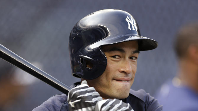 New York Yankees' Ichiro Suzuki warms up for a baseball game against the Toronto Blue Jays at Yankee Stadium, Wednesday, Aug. 21, 2013, in New York. Entering the game, Suzuki is one hit away from reaching the 4,000 career hits plateau, combining his record from Japan's Pacific League and major league baseball. (AP Photo/Kathy Willens)