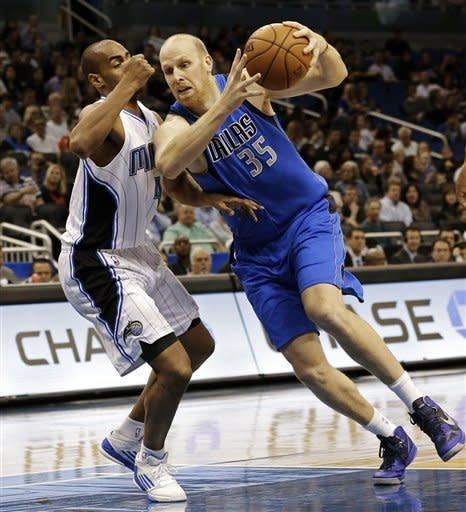 Mavericks hold off late Magic surge in 111-105 win